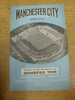 30/11/1963 Manchester City v Huddersfield Town  (stained, rusty staple). Thanks