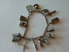 Sterling silver charm bracelet with charms. 1930s-early 1940s