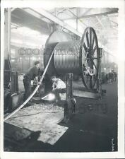 1932 1930s Workers Wind Giant Spool of Cable Factory Location Unk Press Photo