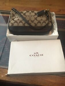 Coach Monogram Shoulder Bag.