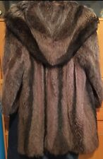 Woman's natural fur coat, knee-length with hood, size 12-18