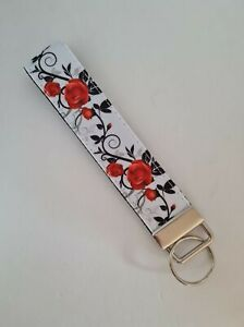 Red black and white rose print key fob wristlet