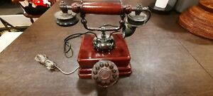 Old fashion home phone corded brown in good condition