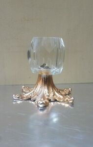 Solid shaped Glass candleholder with golden flowery metal base