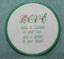 LOVE PUTS A TWINKLE IN YOUR EYE AND A SMILE IN YOUR HEART  finished crossstitch