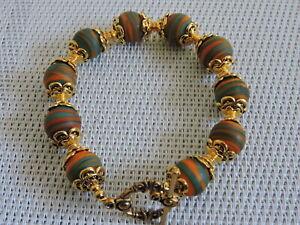 bracelet perles de murano faite au chalumeau orange et verte p int p or