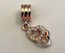 ROSE GOLD INTERLOCKING HEARTS WITH SPARKLING CUBIC ZIRCONIA STONES.