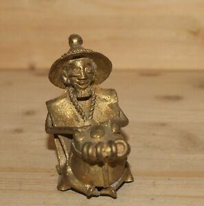 Vintage hand made bronze figurine African man play on drum