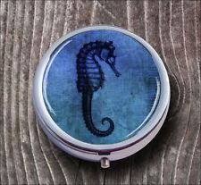 SEA HORSE IN BLUE PILL BOX ROUND METAL -g4r5b
