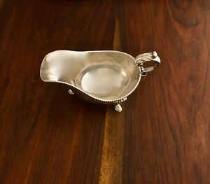- BARKER-ELLIS ENGLISH SILVERPLATE SAUCE BOAT ON 3 SHELL FEET BIRMINGHAM 1912–35