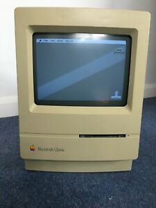 Apple Macintosh classic computer with keyboard, mouse and case