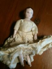 """Vintage Doll w/ Porcelain head, arms and legs. 6 3/4"""" tall. Original Dress."""