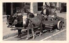 c.1915? RPPC Ox/Donkey Cart near Insurance Agency DeLand FL