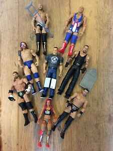 WWE figures, collapsible desk and contract