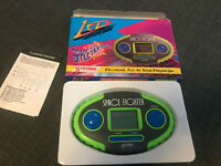 Electronic Lcd Hand Held Game Space related. Like Nintendo Watch & systema
