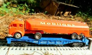 Lionel 16307 Nickel Plate O Gauge Flatcar with Revell 1956 Red Mobilgas Tanker