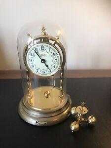 # 34- CLOCK - GERMAN MADE SCHATZ & SONHNE TORSION CLOCK WITH GLASS DOME