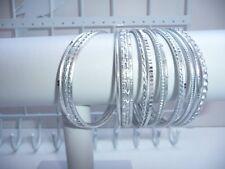 Silver 16 single piece Indian bangle set.