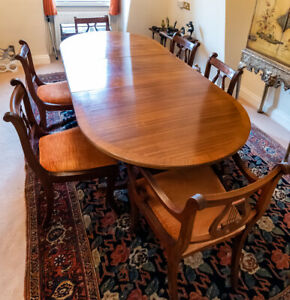 Extending Mahogany finish dining table with 6 lyre back chairs in orange velvet