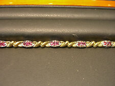 FINE DIAMOND AND RUBY BRACELET ESTATE 14 KARAT WHITE AND YELLOW GOLD 1.50 CARAT