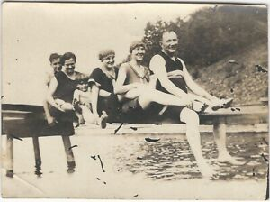 Man Holds Woman's Ankles Swimsuit Group on Lake Shore Dock Vintage Snapshot