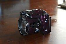 used once Nikon Coolpix Camera. Purple. Excellent condition. Battery operated