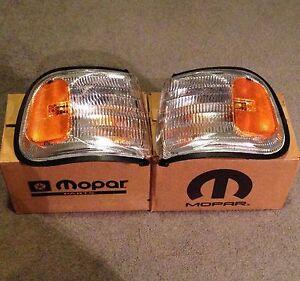 NOS Mopar, Parking/Turn Signal Lamp Housing Pair. 1994-1997 Dodge/Plymouth Van.