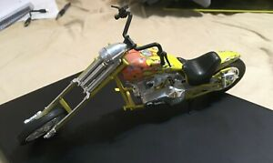 "Yellow motorcycle die cast, barbwire and flames, 10"" plastic, great condition"