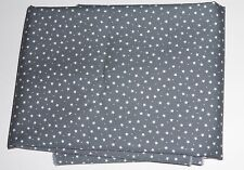 one metre cotton poplin with tiny white stars and spots on dark grey background