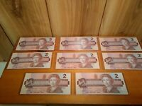 Canada $2.00 paper money lot of 8 uncirculated bills in heavy sleeves