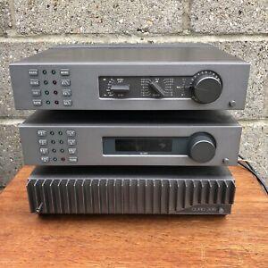 Quad 306 Power Amplifier FM4 Tuner 34 Control Unit. All three fixed in Quadrack.