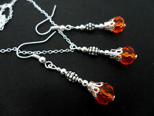 A SILVER PLATED ORANGE CRYSTAL  NECKLACE AND  EARRING SET. NEW.
