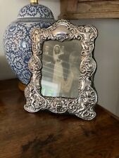 More details for a lovely sterling silver photo frame. free postage.