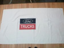 FORD WHITE BEACH TOWEL WITH RED, WHITE & BLUE FORD  HEAVY TRUCK EMBLEM IN CENTER