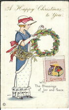 Ba-139 - A Happy Christmas, Girl in Hat with Wreath Basket , 1907-1915 Postcard