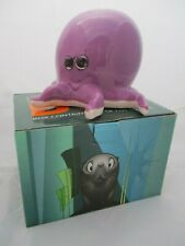 Charming octopus piggy bank in purple