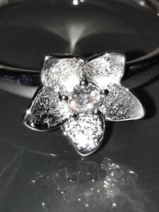 0.10 ctw Moissanite Flower Ring in Platinum Over Sterling Silver Size 7 or 8