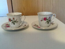 Tea cups and Saucers made in China 1 stamped with a Swan the other, H and leaves