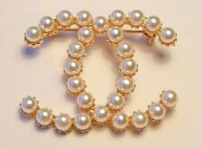 pearls broach . Gold colour metal,white faux