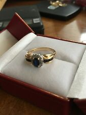 Genuine 14 karat yellow gold diamond and sapphire ring size 6