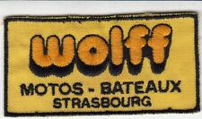 ECUSSON TISSU BRODE *WOLFF MOTOS-BATEAUX / STRASBOURG*  (9.5 CM X 5.8 CM)