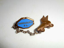 Old enamel brass pin for Skating Team Harrisburg P.A.