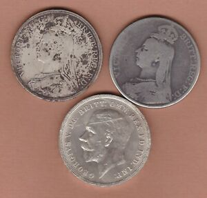 THREE 1889/1890 VICTORIA & 1935 GEORGE V SILVER CROWNS IN A WELL USED CONDITION