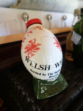 New listingminiture welsh whiskey bottle rugby ball empty