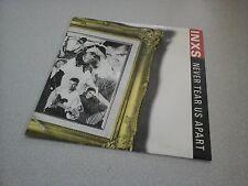 "INXS : Never tear us apart (vinyle 45 tours / 7"" Vinyl)"