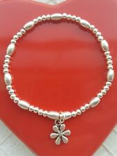 silver plated stretchy stacking bracelet with flower charm