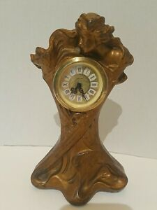 """Art Nouveau Spelter Table clock 9"""" tall 5"""" wide, needs clock fixed or replaced."""