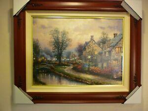 "Thomas Kinkade framed canvas classics ""Lamplight Lane"" 18"" X 24"", brandy"