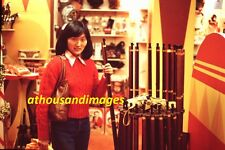 35mm Slide Photo/Pretty Asian Woman In Gift Shop Holding Vintage Toy Rifle SL241