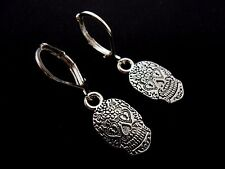 A PAIR OF TIBETAN SILVER SUGAR SKULL THEMED  LEVERBACK HOOK EARRINGS. NEW.